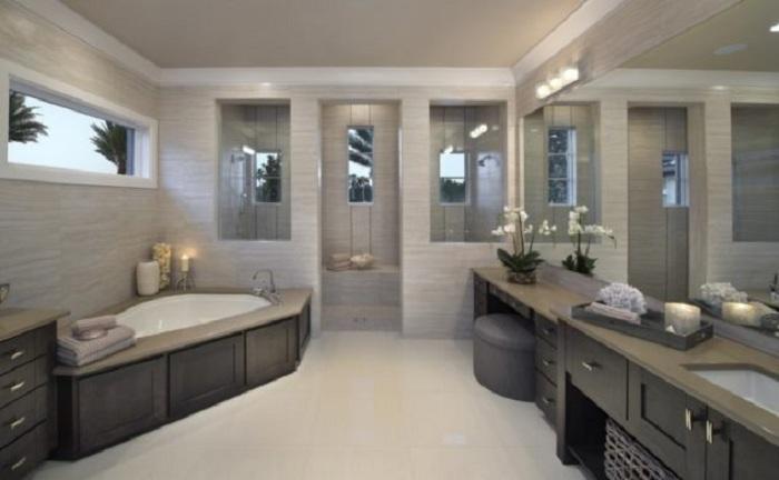 Стильная ванная комната облагорожена благодаря отменному оформлению гипсокартонной стены.