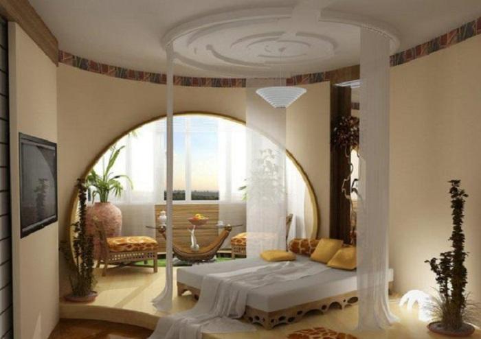 Прекрасный вариант оформления оригинальной гипсокартонной арки в комнате, что создаст утонченную обстановку.
