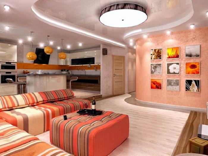 Освещение - важная часть интерьера гостиной.