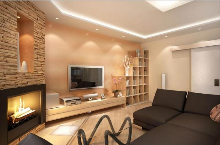В гостиной в пастельных тонах и с каминов в углу всегда царит теплая атмосфера.