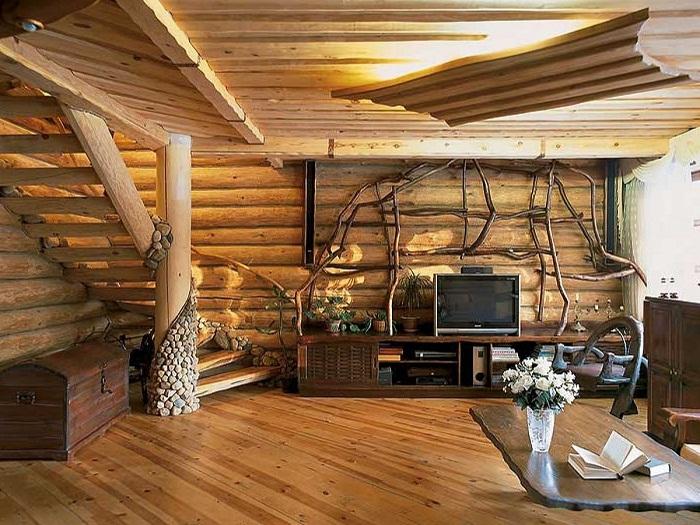 Потрясающая гостиная стены в которой выполнены с деревянных срубов, что выглядят очень красиво и необыкновенно.