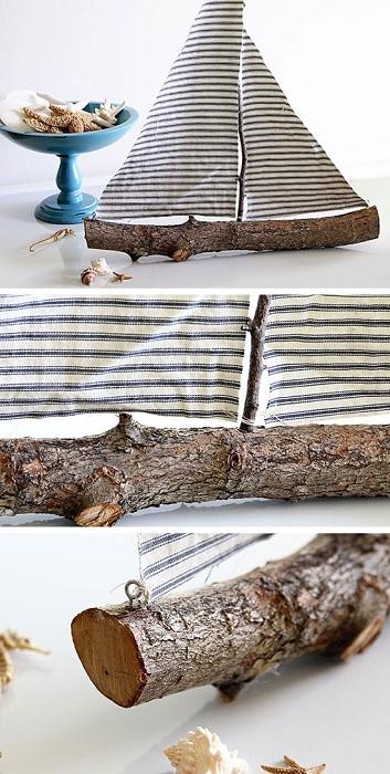 Идеальный парусник выполнен из деревянной ветки, то что создает определенный шарм.
