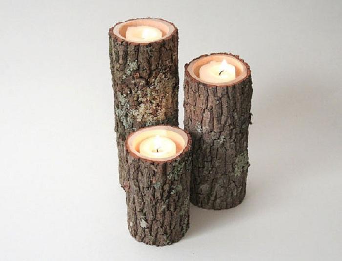 Один из самых нестандартных вариантов создать подсвечники из подручных материалов, например, из дерева.