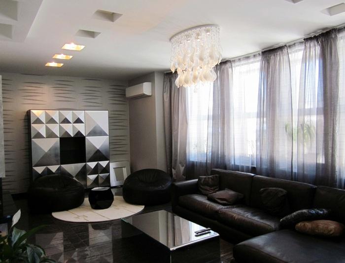 Интересный темный интерьер гостиной, то что понравится и очарует с первого взгляда.