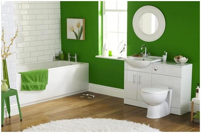 Ванная комната декорирована в ярком зеленом цвете.