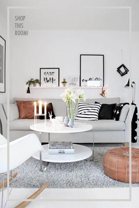 Светло-серая гостиная отлично обустроена очень неплохой мебелью.