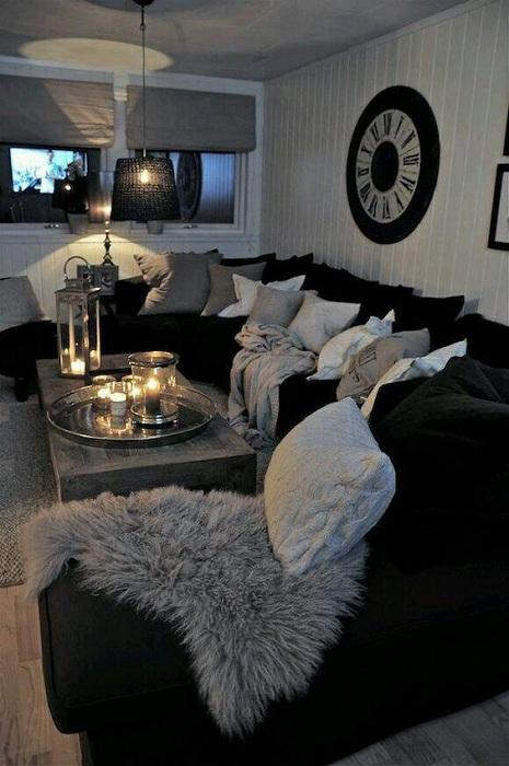 Интересное и в тоже время не яркое оформление гостиной в серых тонах.