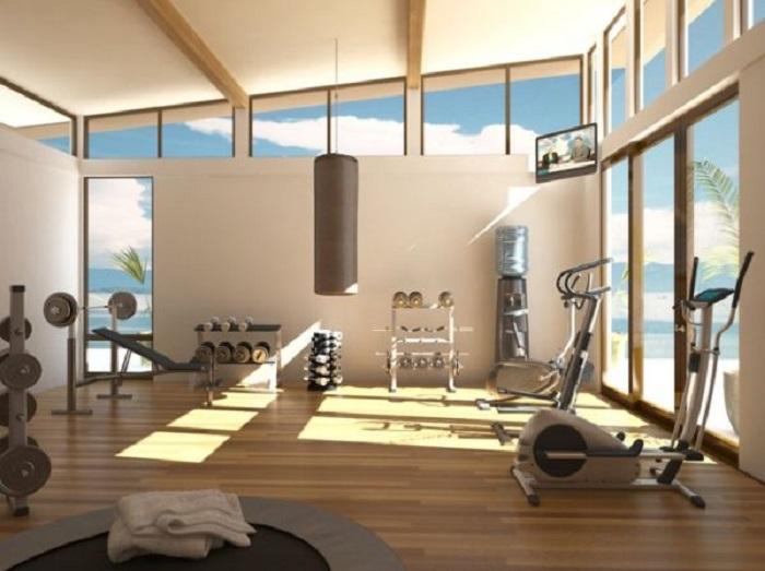 Хорошо освещенный тренажерный зал создаст комфортную обстановку для занятий спортом дома.