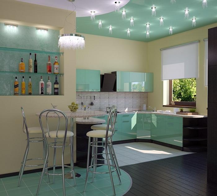 Оригинальный интерьер кухни в оливковых оттенках с симпатичным интерьером.