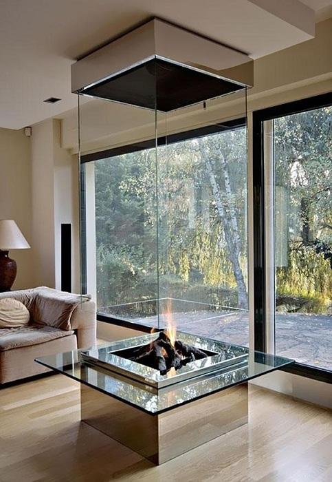 Отличное решение разместить просто удобный и стильный камин прям в центре комнаты, что станет находкой.