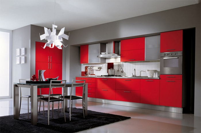 Кухонный гарнитур оформлен в малиново-сером цвете предает определенный шарм и стиль кухне и дает возможность получить максимальное удовольствие от такого стиля оформления.