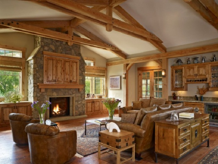 Сочетание деревянной мебели с каменным камином и отличным видом из окна.