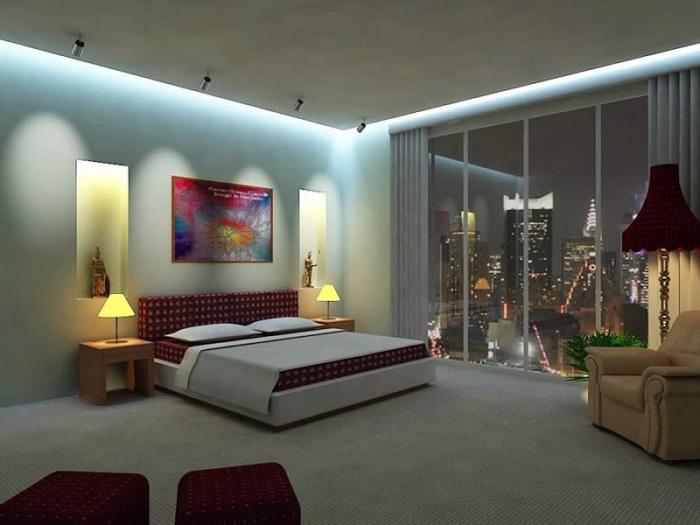 Отличное оформление спальни при помощи светильников, которые создали возможность для отличного времяпровождения в постели с любимой книгой.