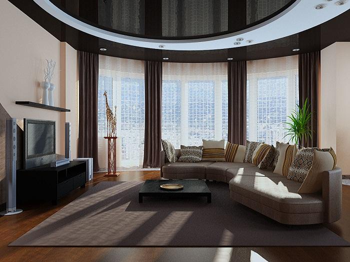 Дизайн гостиной стал специфичен благодаря оригинальным округлым линиям, что создают не только легкие линии, но и определенный шарм комнаты.