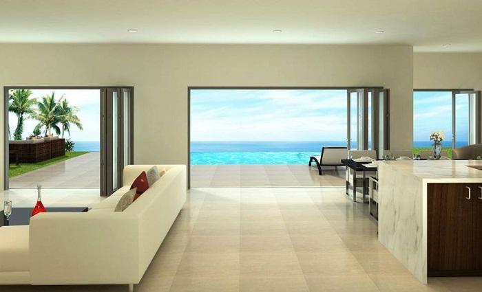 Хорошенький вариант создать интерьер гостиной в сливочных тонах, что выглядит очень мягко и приятно одновременно.