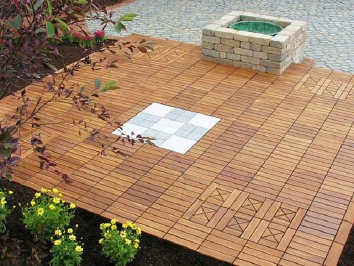 Простой и интересный вариант оформления деревянной площадки во дворе, что станет хорошим элементом декора.