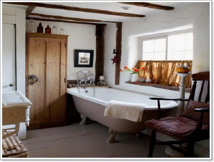 Оригинальный рустикальный стиль в оформлении ванной комнаты заметен и отличителен.