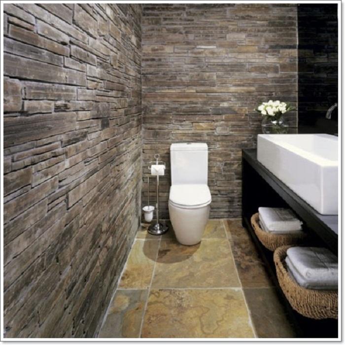 Один из самых интересных и удачных вариантов оформления ванной комнаты при помощи симпатичной и элегантной каменной кладки.