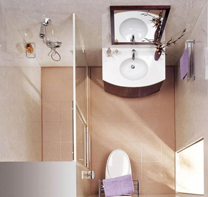 Разместить стеклянную душевую кабинку отличный вариант при декорировании крохотных площадей ванной комнаты.