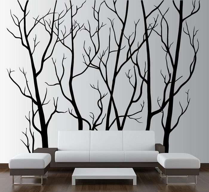 Шикарное сочетание черного и белого, особенно тонких линий нарисованного дерева на стене подчеркивают индивидуальность оформления интерьера.