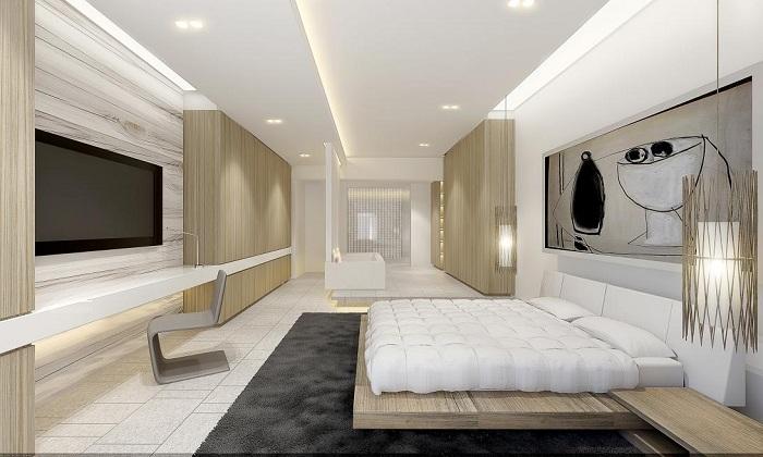 Интерьер современной спальни в светлых тонах.