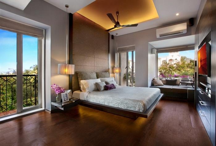 Интересное оформление интерьера спальни в современных тенденциях.