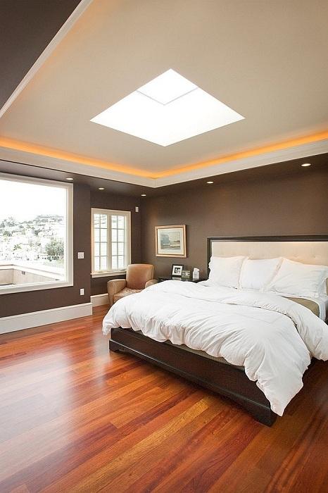 Шоколадные цвета в оформлении интерьера спальни позволяют приблизится к уюту и нежной обстановке дома.