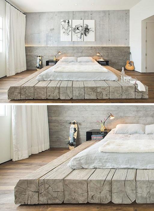 Очаровательный интерьер преображен с помощью нестандартной кровати на деревянной платформе.