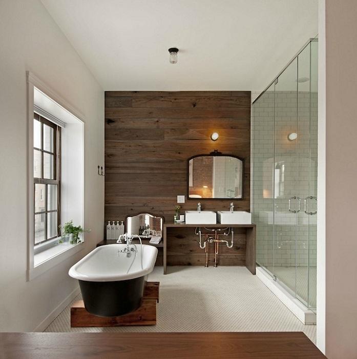 Ванная комната оформлена в современных тенденциях.