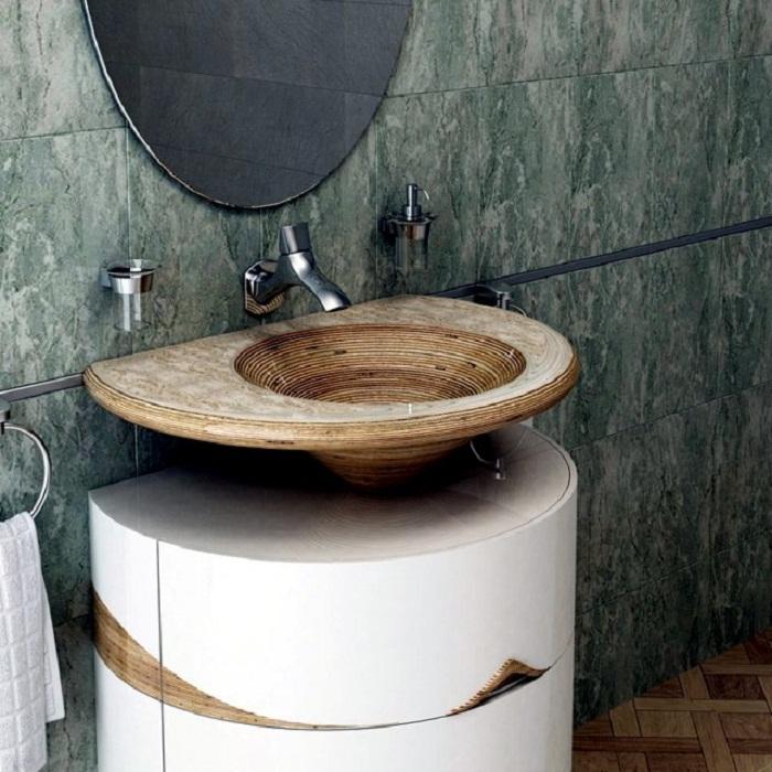 Преобразить пространство в ванной комнате возможно за счет крутой раковины, что вдохновит.