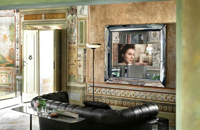 Выполняет функцию зеркала, решает проблему с размещением телевизора и стилистикой интерьера
