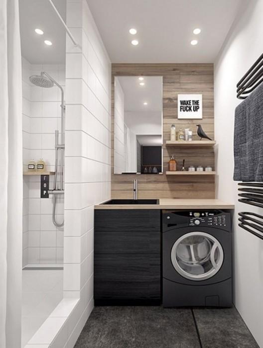 Оригинальная планировка небольшой ванной комнаты позволила оборудовать её всей необходимой сантехникой и аксессуарами.