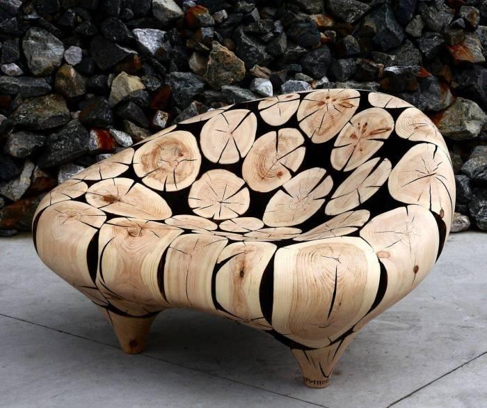 Фантастическое кресло из цельного куска древесины для настоящих любителей современных экостилей.