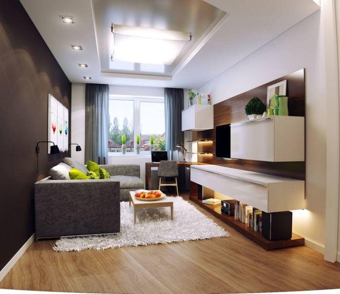 Небольшая гостиная комната в светлых и серых тонах выглядит аккуратно и свежо.