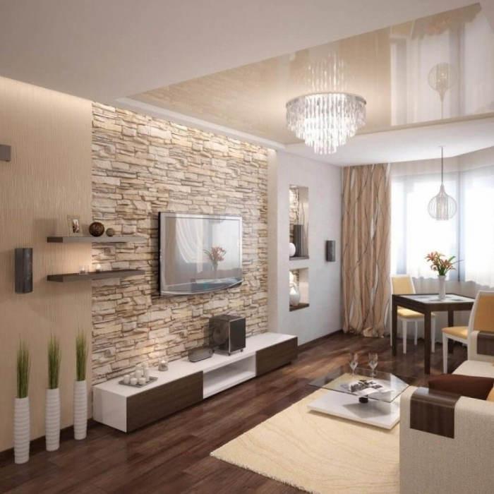 Использование декоративного камня в гостиной комнате - довольно частый приём, который позволяет выделить зону для просмотра телевизора.