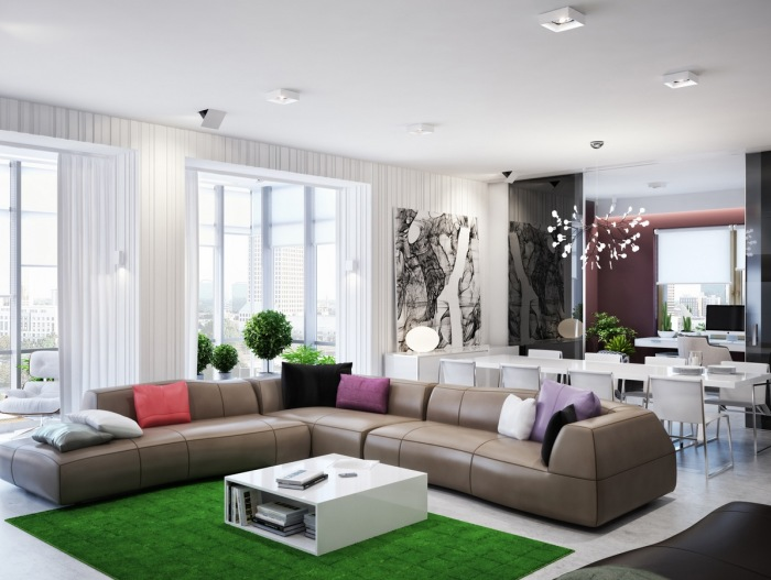 Просторная гостиная комната с роскошной мебелью и ярким зеленым ковром.