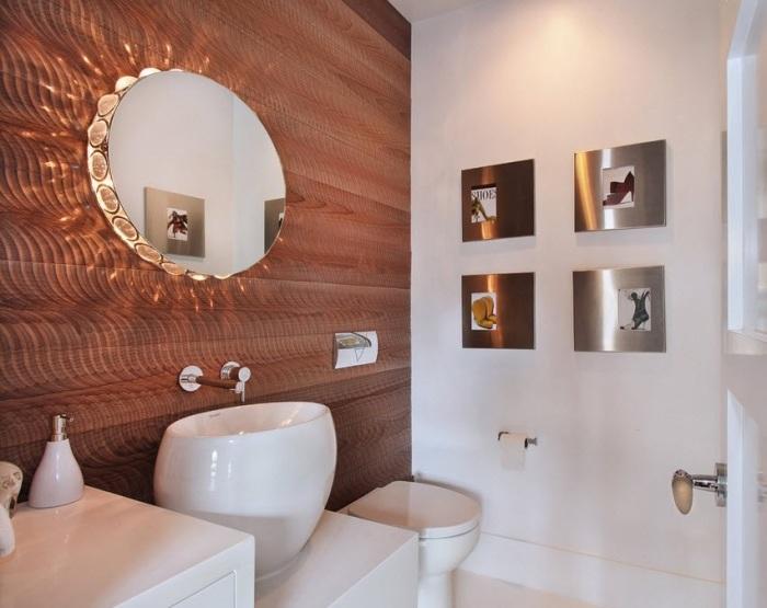 Овальная форма раковины в ванной комнате с максимально функциональным и минимальным декором.