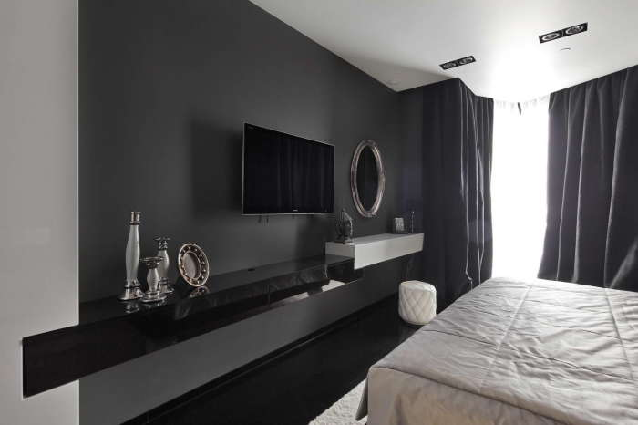 Пара контрастных цветов и минималистский стиль составили основу для современного интерьера спальни.