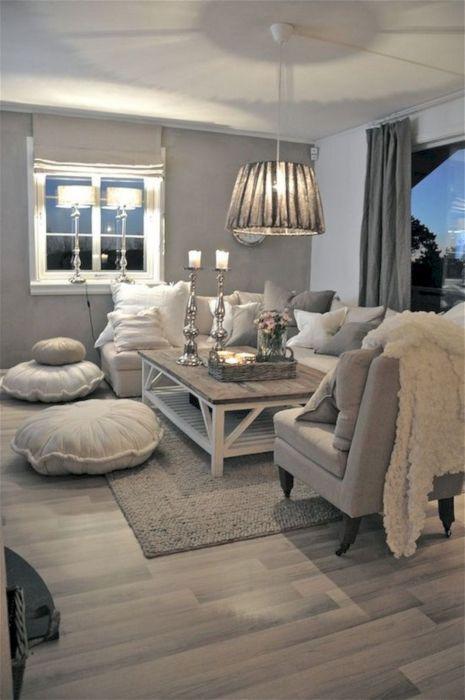 Интерьер гостиной комнаты в сером цвете может быть оформлен практически в любом стилистическом направлении.