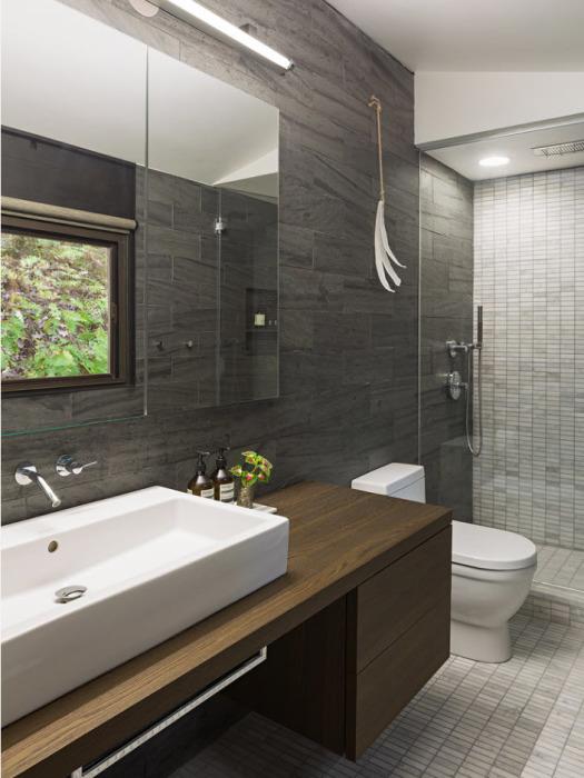 Искусственный аналог натурального камня в интерьере ванной комнаты.