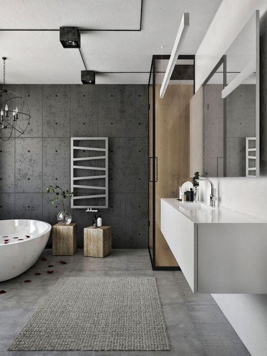 Просторная ванная комната с классической массивной плиткой серого цвета, которая идеально вписывается в современный интерьер.