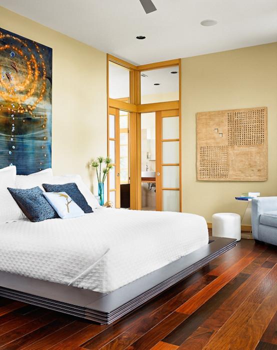 Оригинальный дизайн-проект спальной комнаты, в которой сделана ставка на простоту и экологичность.
