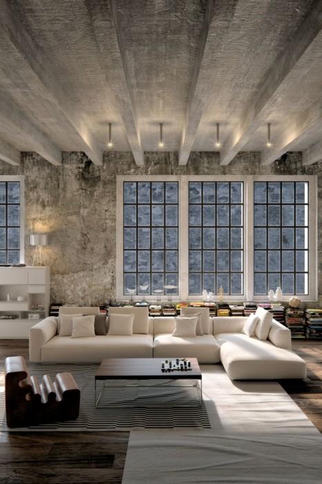 Просторная гостиная комната в стиле лофт с бетонными стенами и потолком.