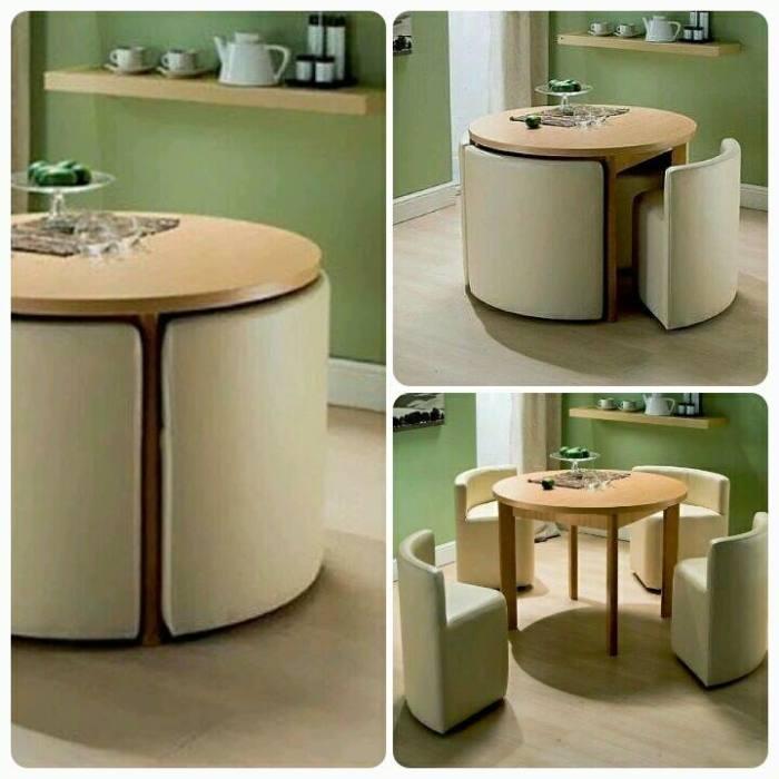 Обыкновенный журнальный столик, который в любой момент можно легко трансформировать в кухонный стол с четырьмя мягкими креслами.
