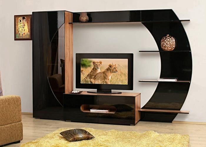 Стильная современная модульная стенка из высококачественных материалов отлично подойдет для гостиной комнаты.