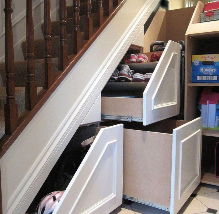 Интересный вариант для рационального обустройства шкафа в нише под лестницей.