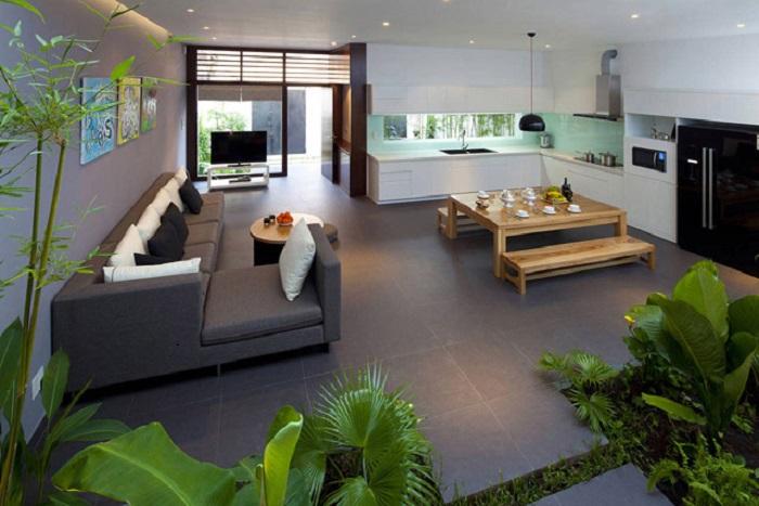 Современная кухня с зоной для отдыха, в которой отлично сочетаются светлые и серые оттенки.