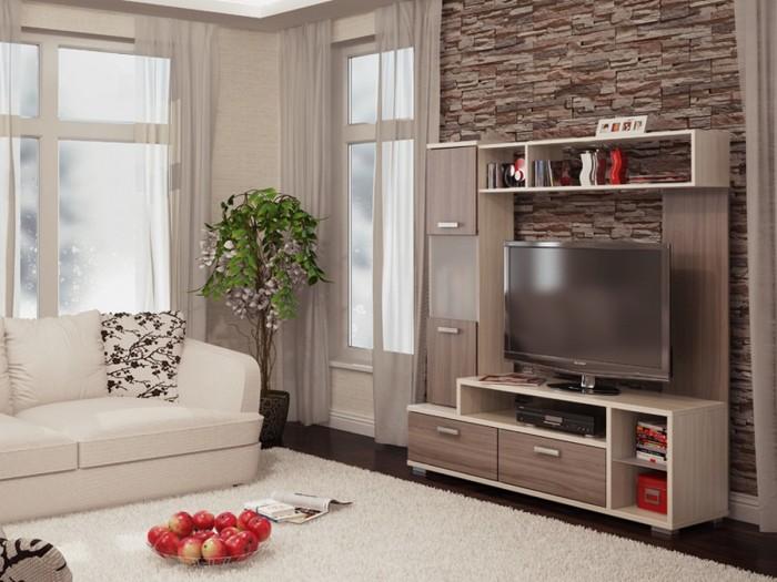 Небольшая модульная стенка станет отличным решением для экономии пространства в гостиной комнате.