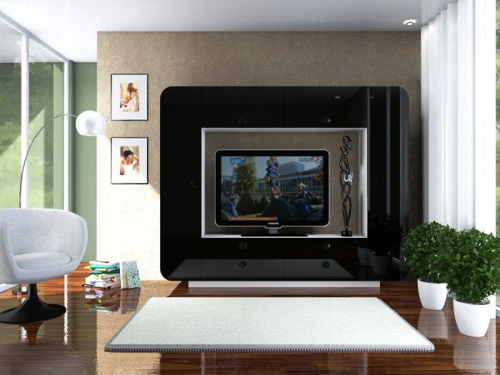 Тёмная модульная стенка под телевизор, которая эффективно вписывается в интерьер гостиной комнаты.