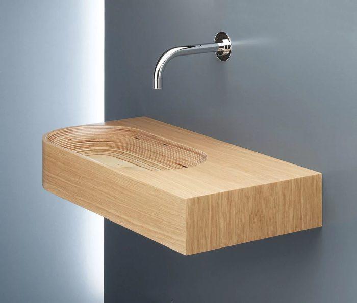 Впечатляющая раковина в ванной комнате, которая создаст тепло и уют.